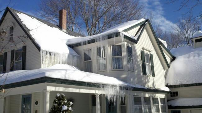 Ice Dams and Icicles on a Camden Maine home | Evergreen Home Performance