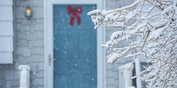 snowy front door of maine house