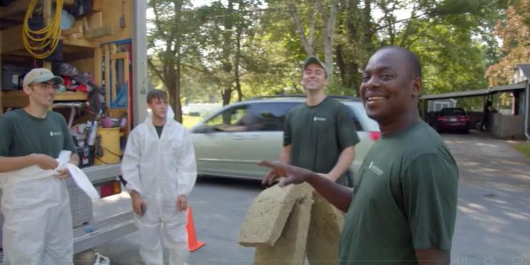 Evergreen Home Performance employees chatting and laughing together outside truck