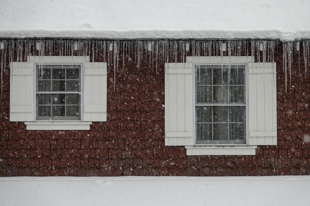 dangerous ice dam on house