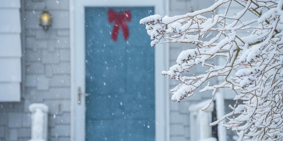snowy front door of maine house